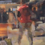 man in red vest striding through the airport